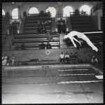 A boy performs a dive at a Boys' Club swimming championship.
