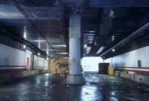 Underground tunnel with center column separating Interstate 90 and Interstate 93 ramps.