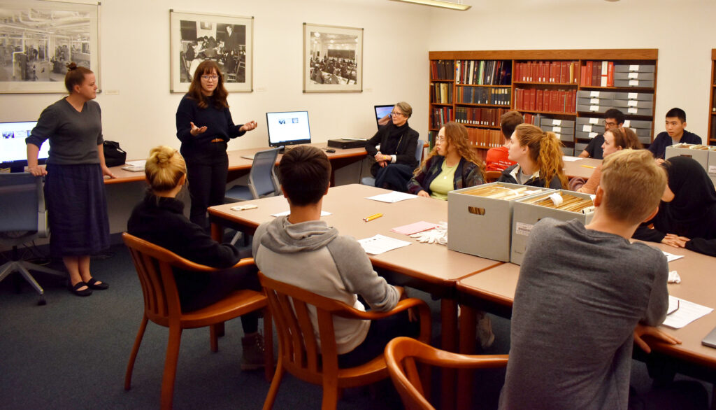 Regina Pagani and Molly Brown teach a class of students in the Archives Reading Room